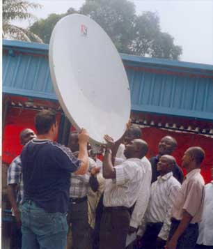 VSAT instructor and participants are ensuring the correct positioning of the dish.